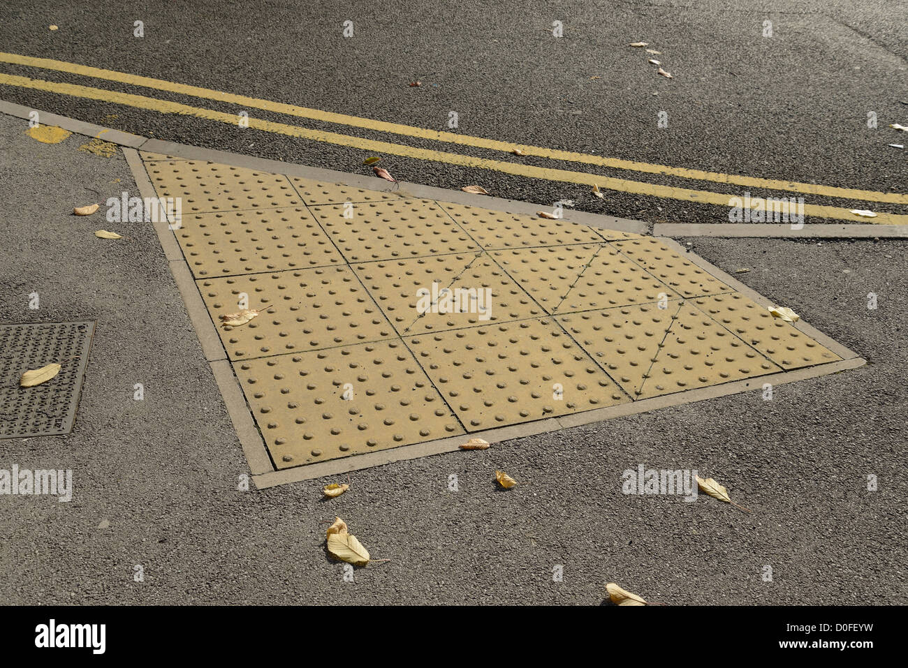 Tactile Paving At The Crossing Point Of A Road To Help