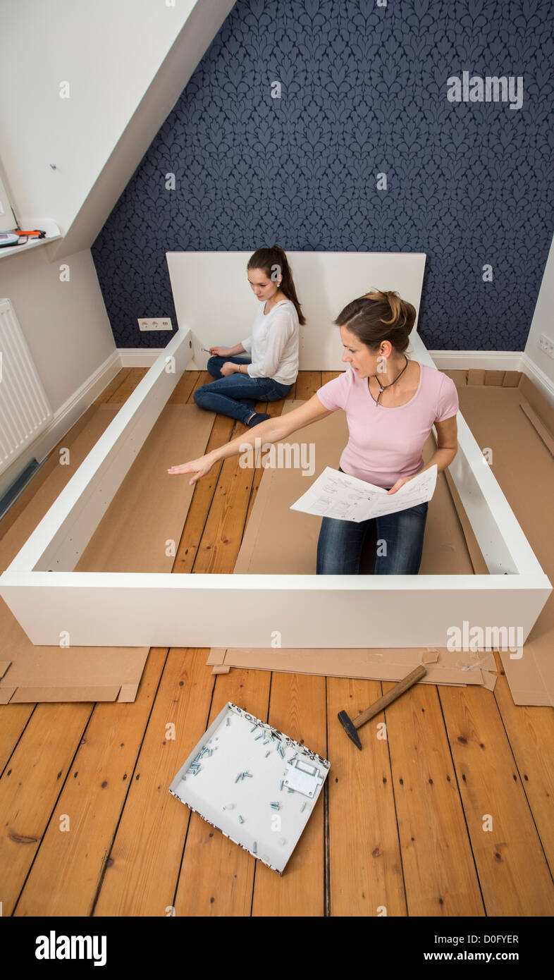 Mother and daughter assemble furniture bed do it yourself home mother and daughter assemble furniture bed do it yourself home improvement solutioingenieria Image collections
