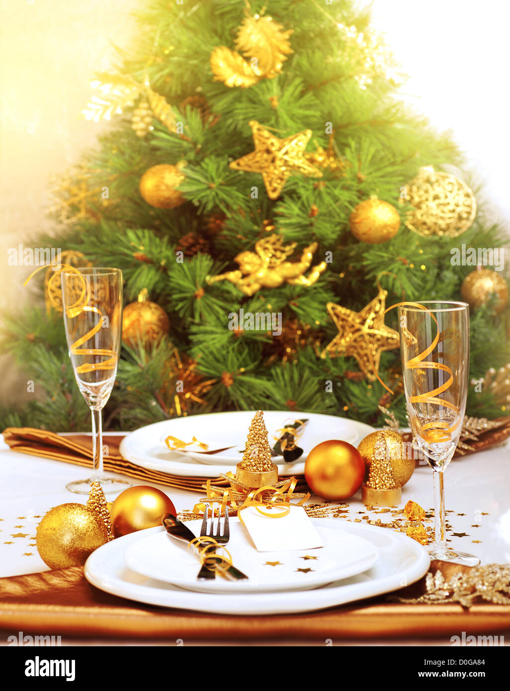 Photo Of Romantic Christmastime Dinner, Luxury New Year Table Setting,  Gorgeous Decorated Christmas Tree By Golden Toys Of Stars
