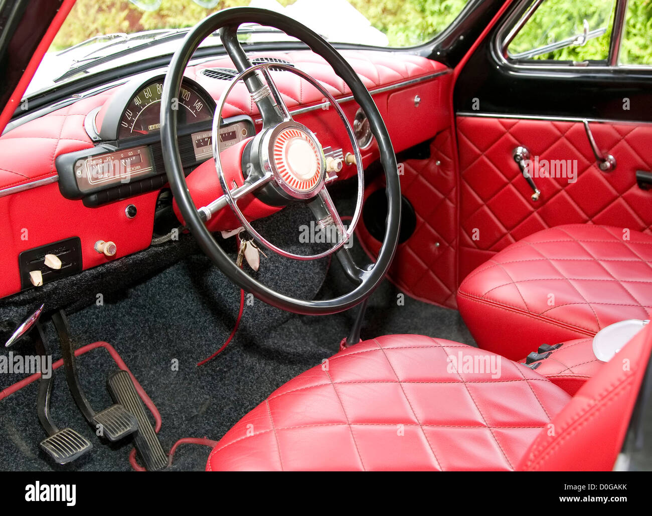 antique car with red interior inside and old black wheel stock photo royalty free image. Black Bedroom Furniture Sets. Home Design Ideas
