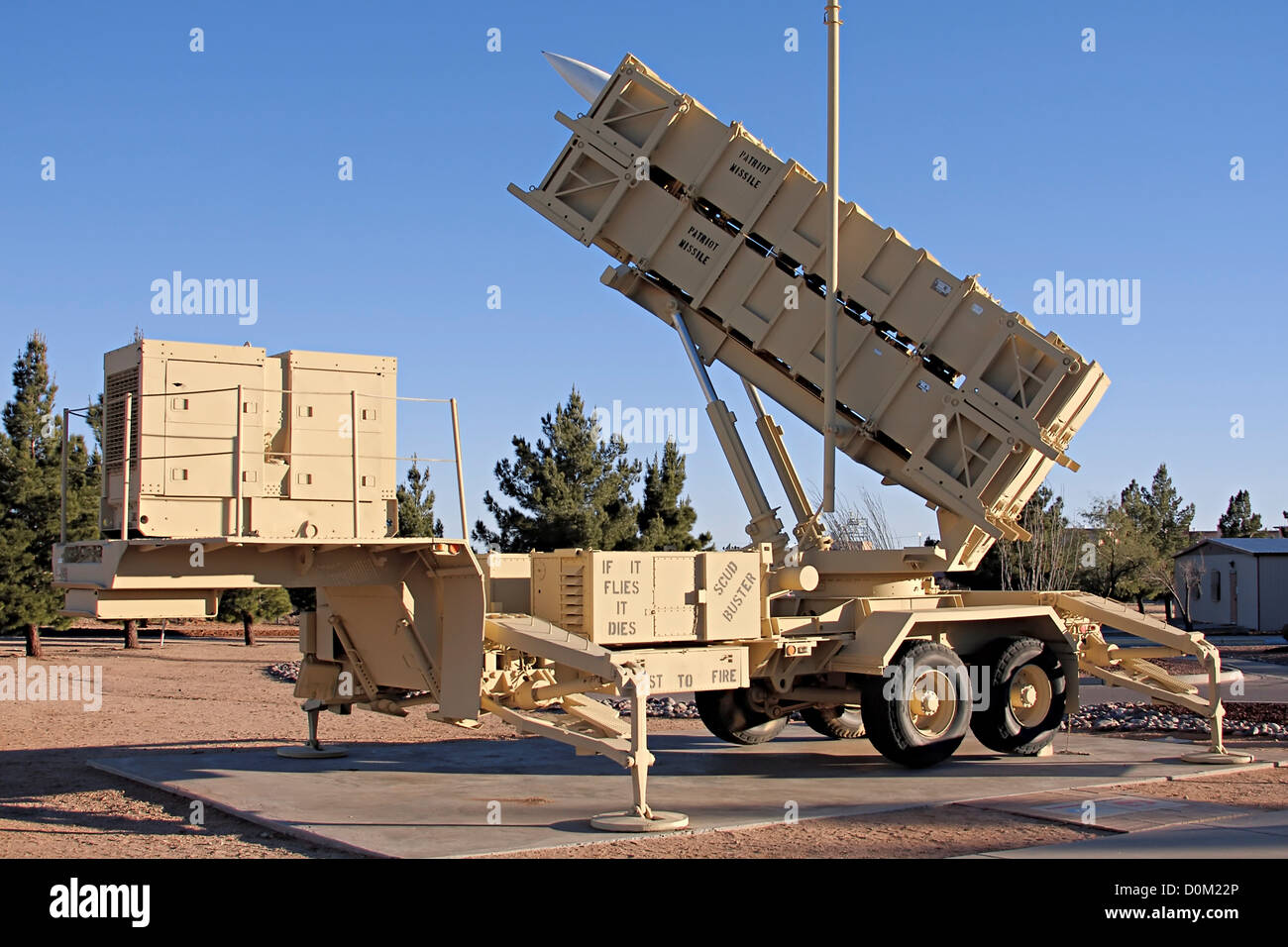 A Patriot missile battery labeled 'SCUD Buster' missile ...