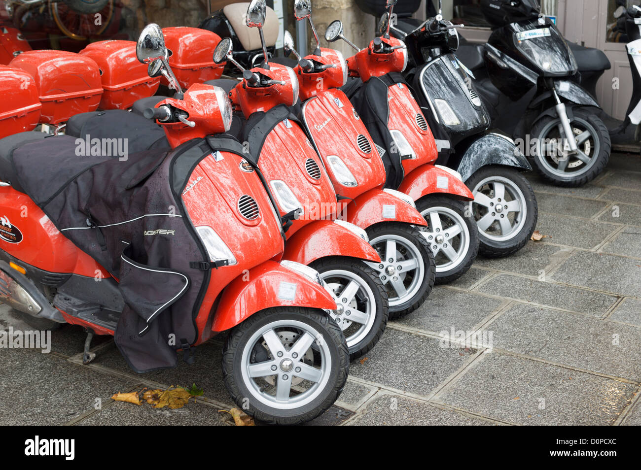 paris france red piaggio vespa motor scooters for hire parked in stock photo royalty free. Black Bedroom Furniture Sets. Home Design Ideas