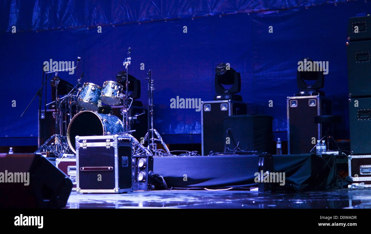 concert speakers setup. atmsopheric background with a set of drums and speakers up on stage in blue concert setup