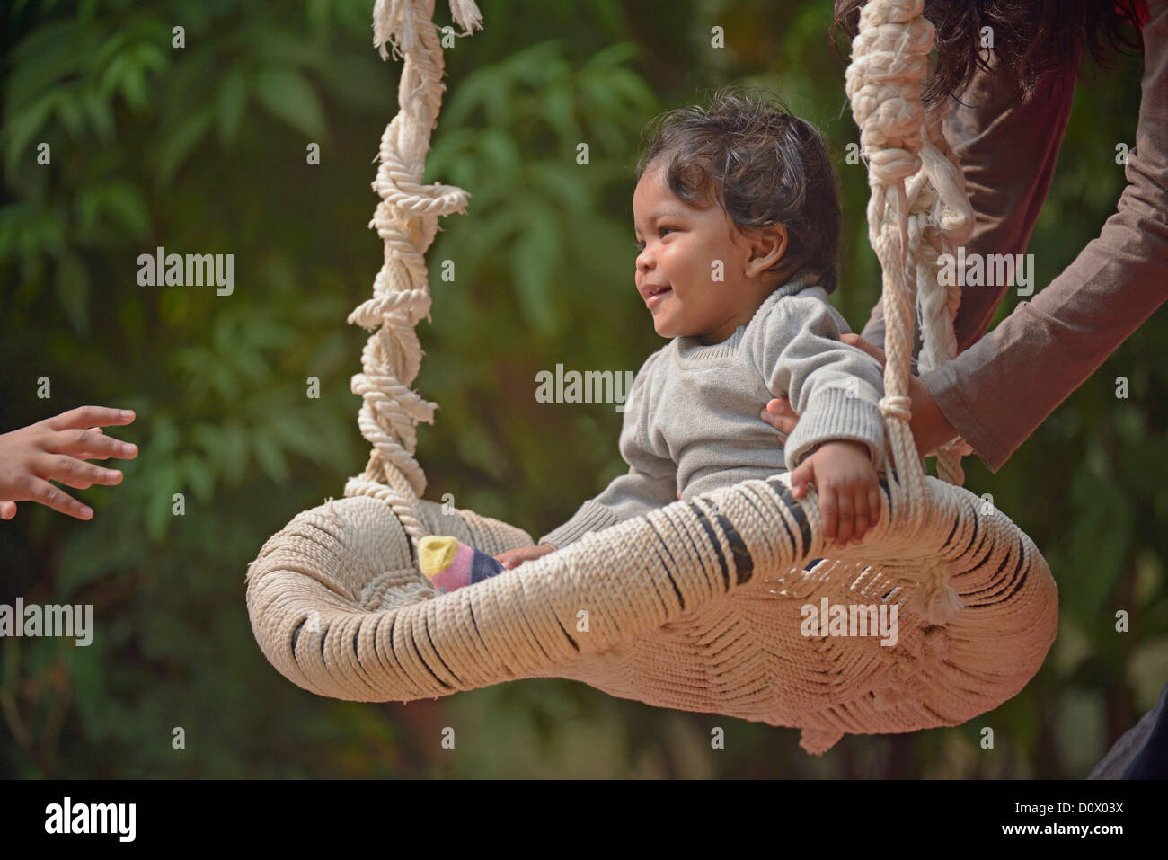 Cute south asian (Indian) baby girl playing on a swing Stock Photo ...