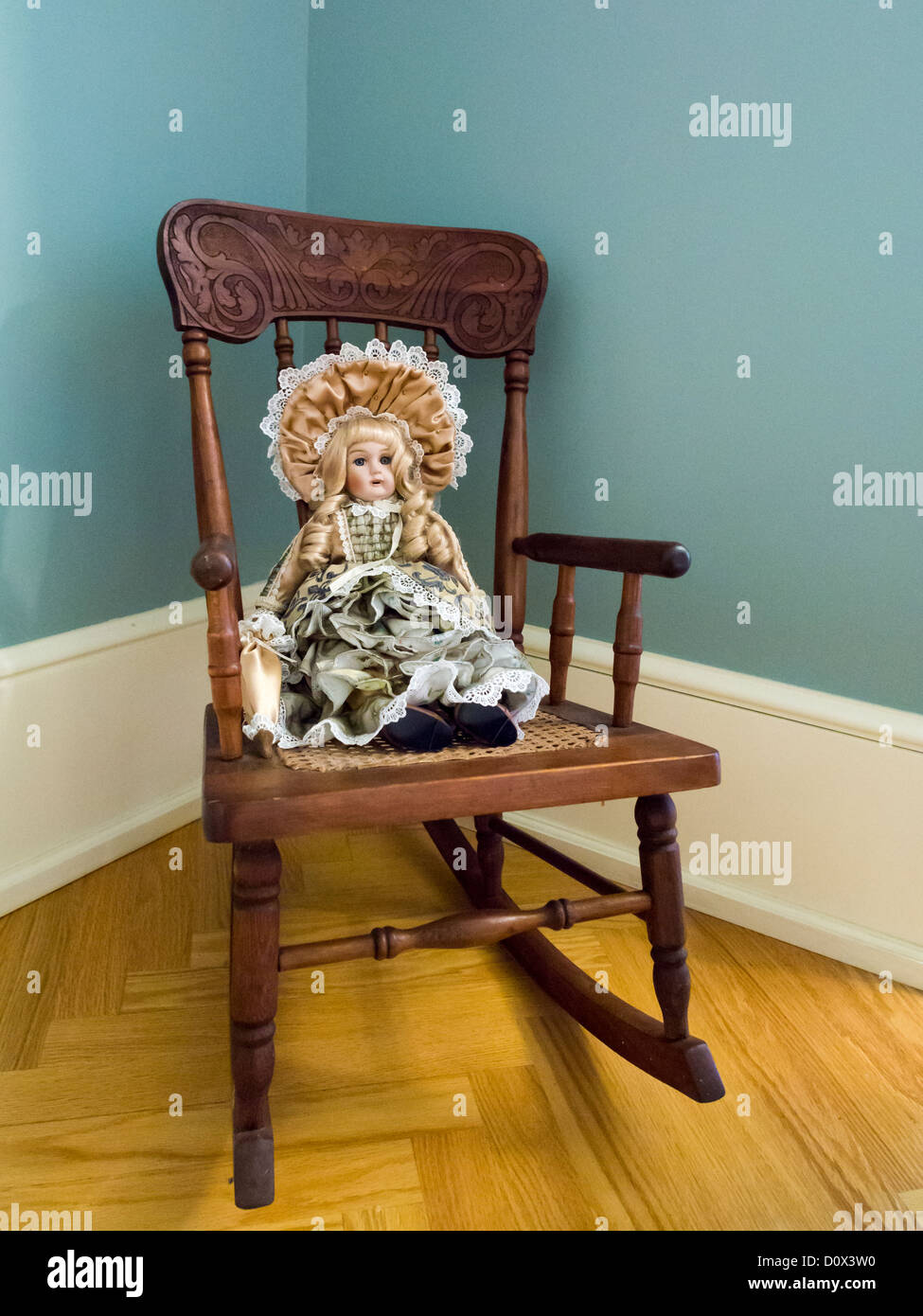 Antique Doll on a Rocking Chair. An old doll seated on an antique rocking  chair decorates Boldt's daughter's room - Antique Doll On A Rocking Chair. An Old Doll Seated On An Antique