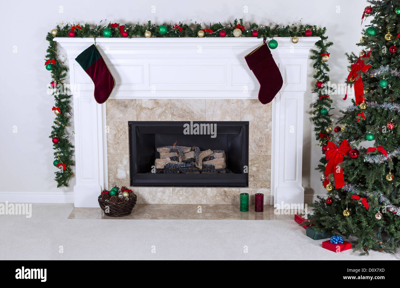 natural gas fireplace decorated with tree ornaments stockings