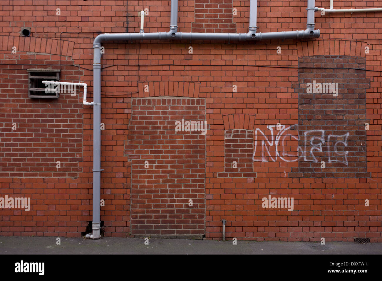 A bricked-up doorway and windows with football graffiti in a vacant retail building during & A bricked-up doorway and windows with football graffiti in a ... Pezcame.Com