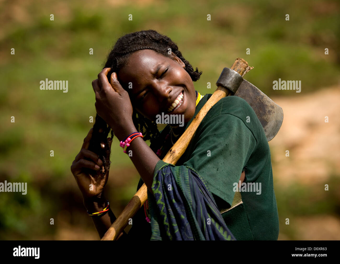 Portrait Of A Young Borana Tribe Lumberjack Woman Tidying Her Hair Stock Photo Royalty Free ...