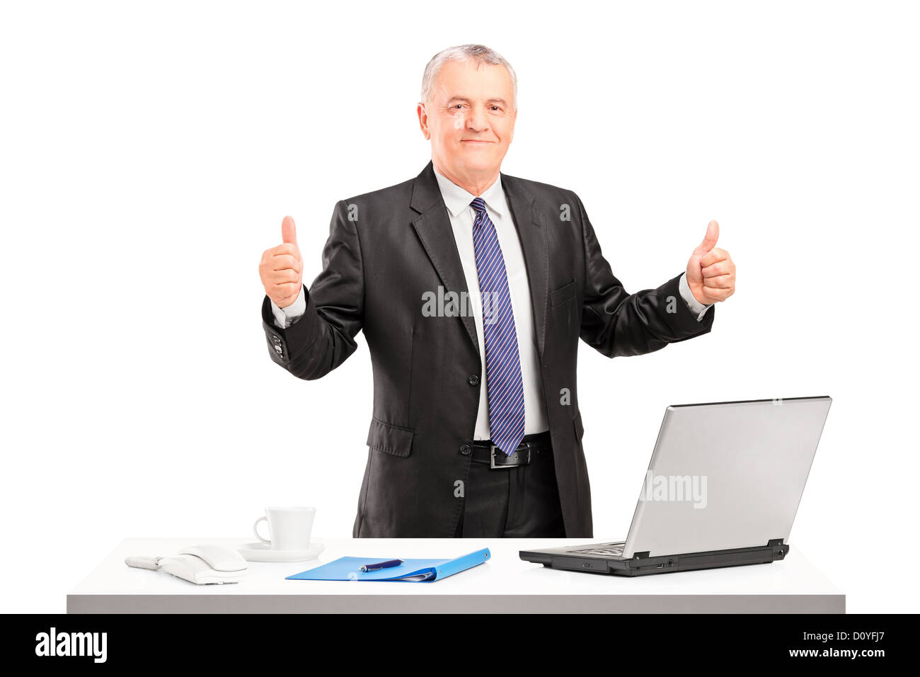 happy mature businessman standing and giving thumbs up isolated on