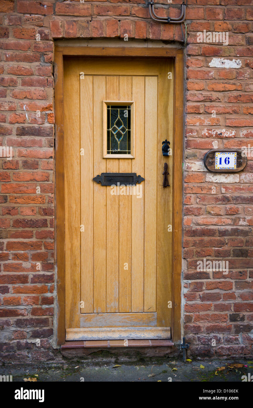 natural wooden front door with frame of cottage at tenbury wells worcestershire england uk