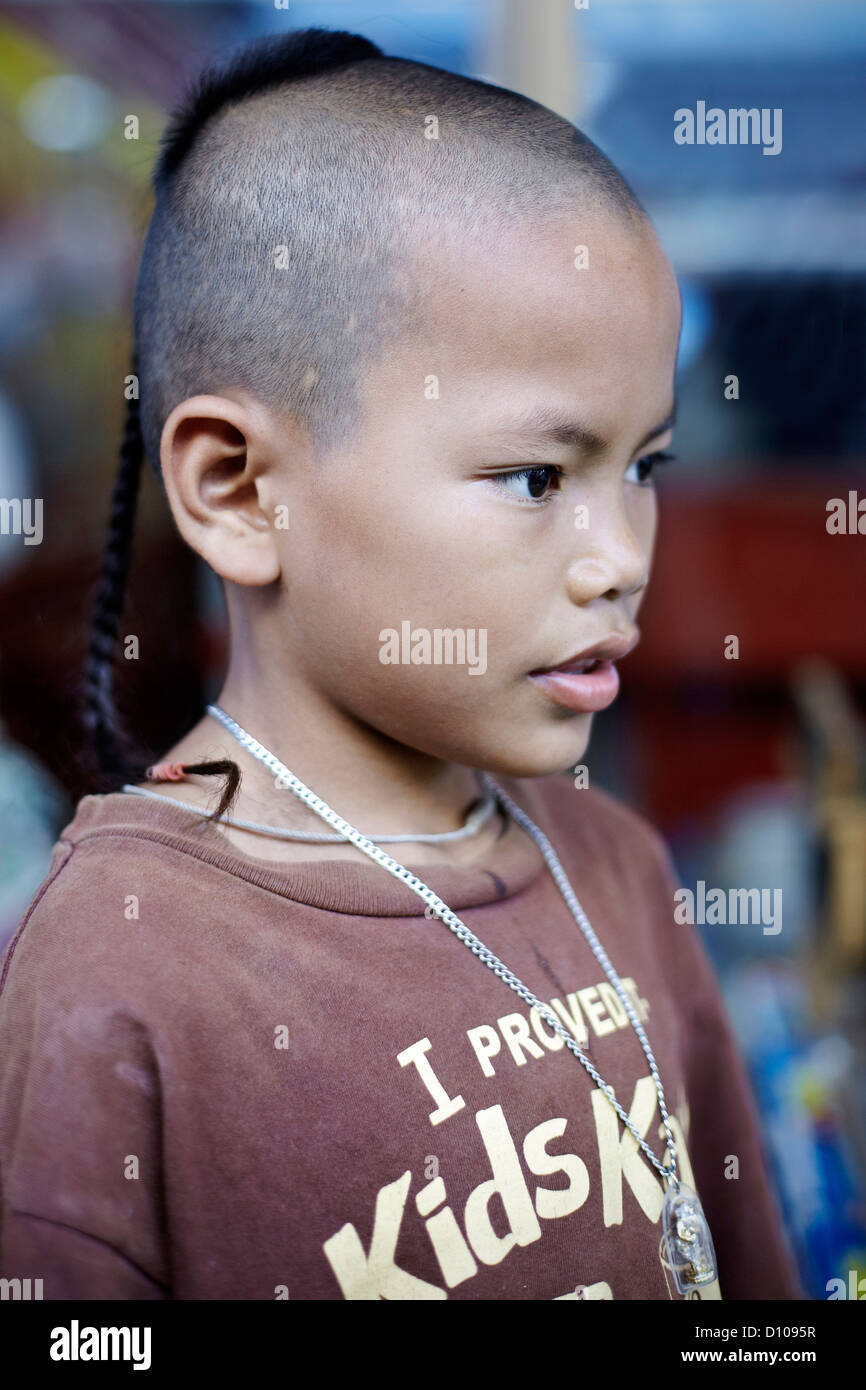 Traditional Top Knot Shaven Head Hairstyle On A Thai Young