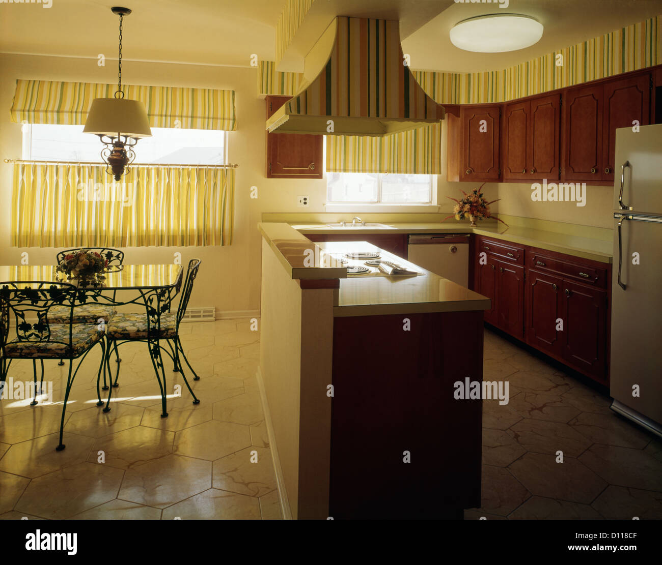 1970s KITCHEN AND DINING AREA WITH YELLOW STRIPED CURTAINS WALLPAPER AND  DARK WOODEN CABINETS