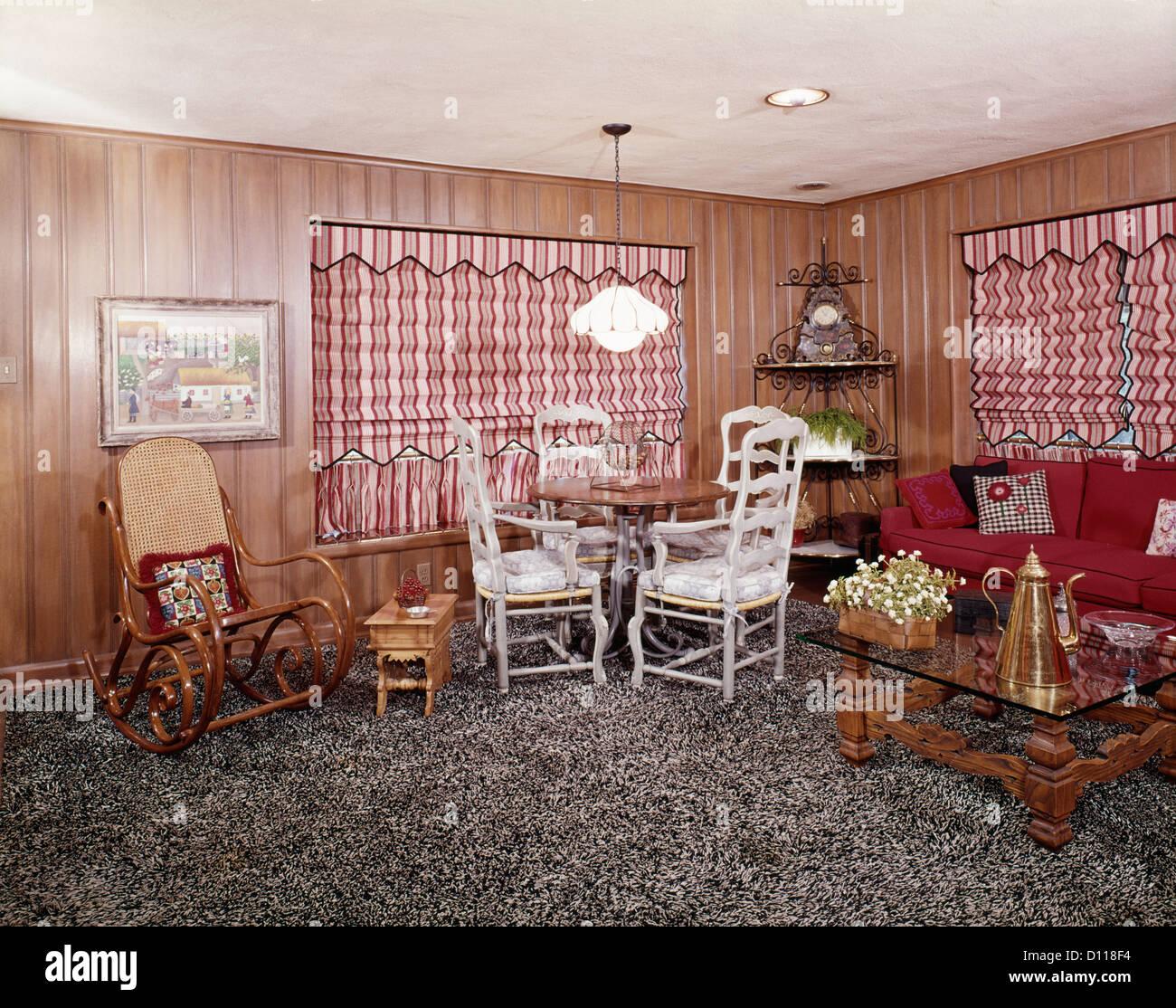 1960s 1970s living room interior shag wall to wall carpet bentwood rocker red stripe roman shades