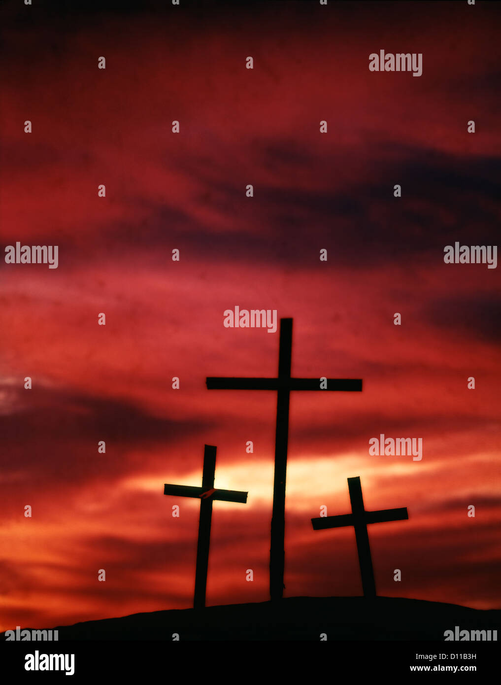 Silhouette of the holy cross on background of storm clouds stock - 1960s Symbolic Three Crosses Of Calvary Silhouetted Against Red Sky Stock Image