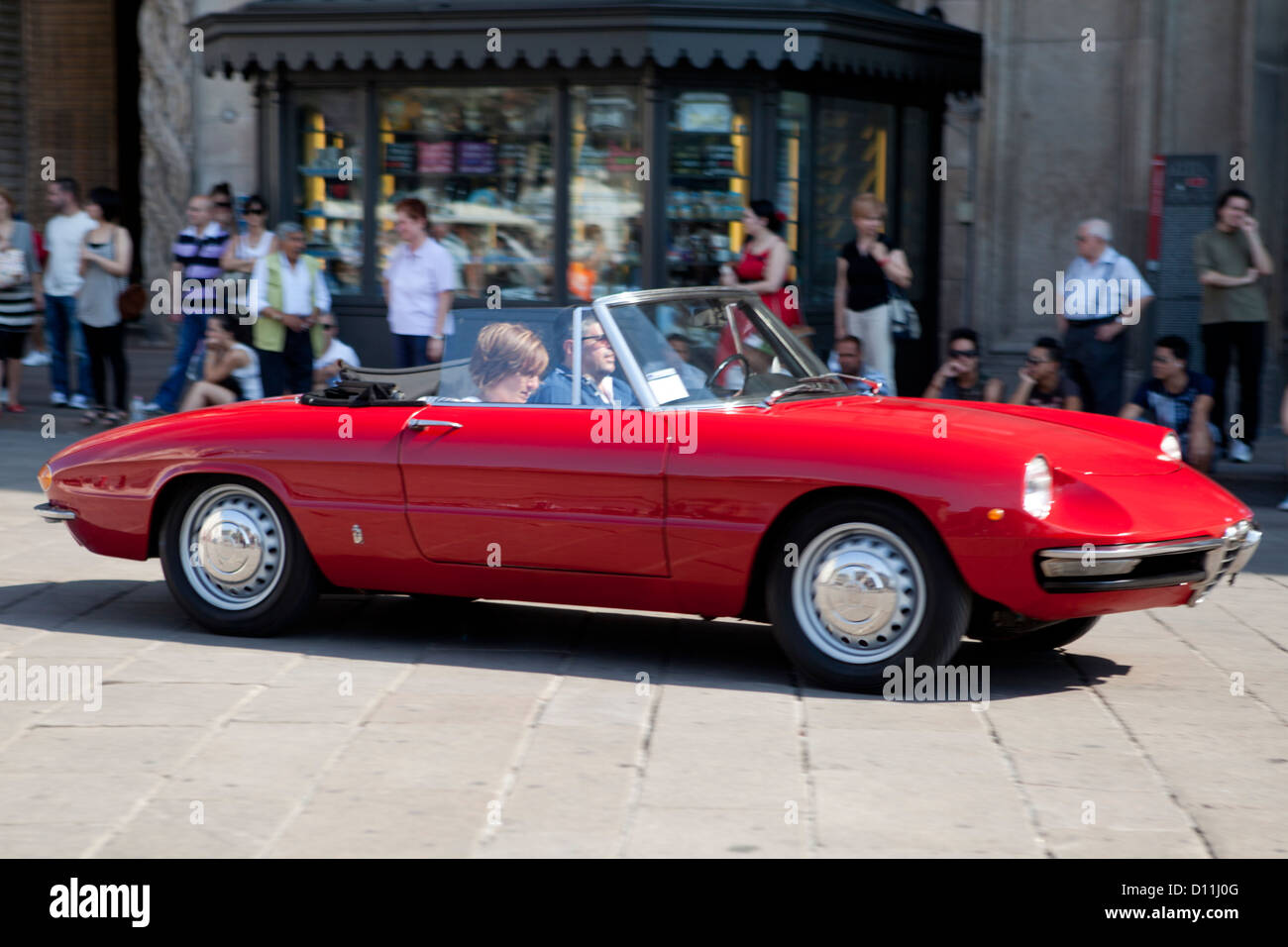 Piazza del Duomo, Milano. Defile of old famous sport cars: here a ...