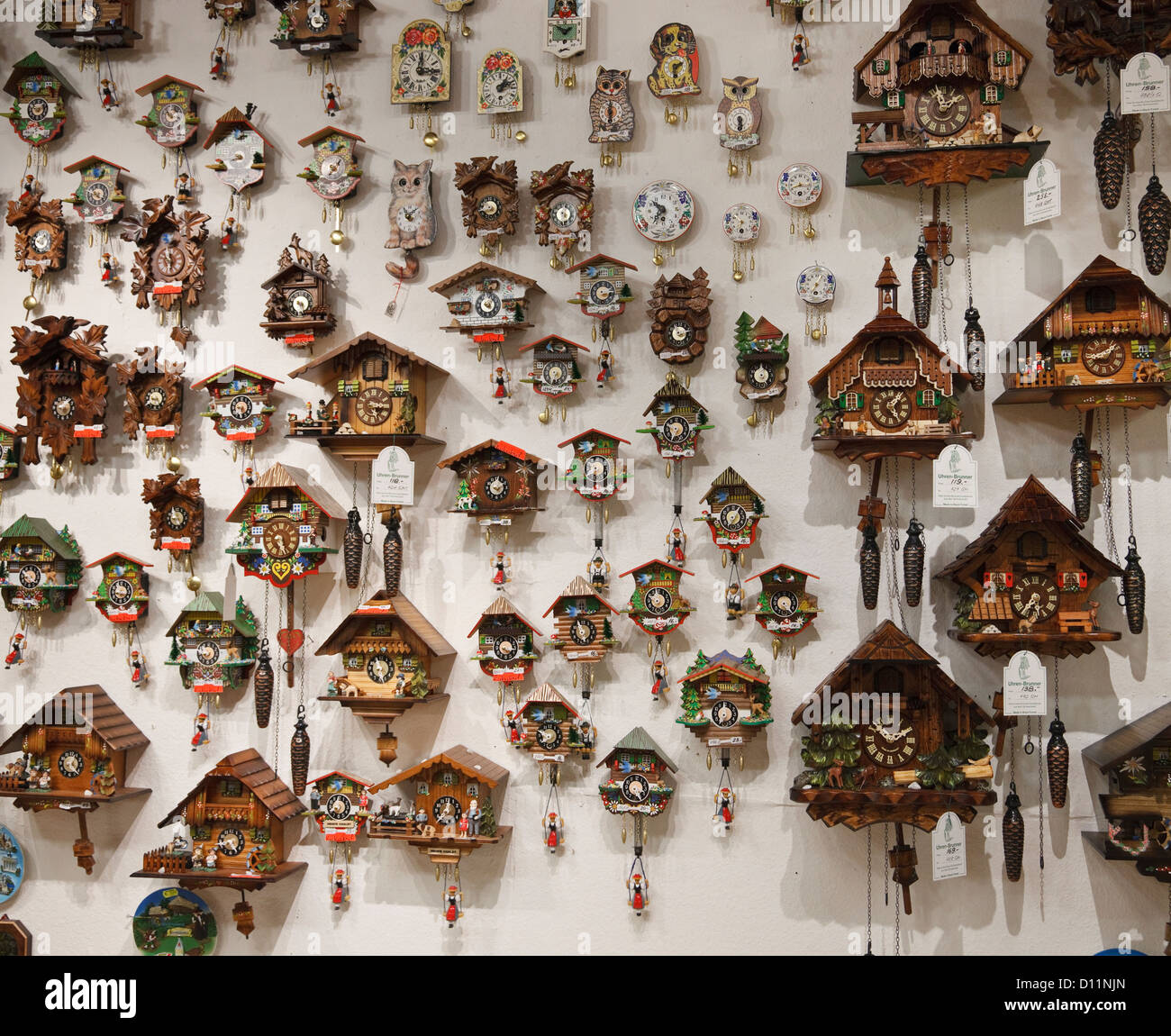 stock photo wall display of cuckoo clocks for sale inside a souvenir shop in germany