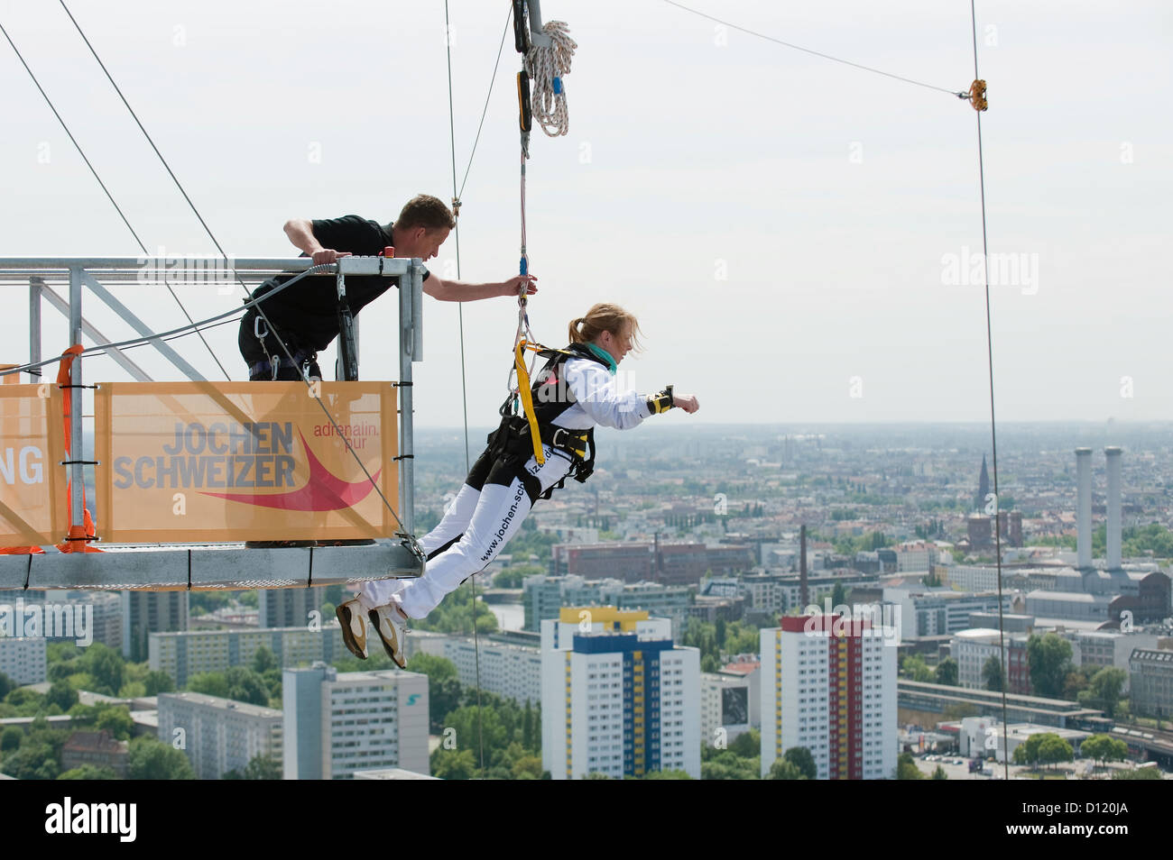 berlin germany bungee jumpers on the roof of the park inn at stock photo royalty free image. Black Bedroom Furniture Sets. Home Design Ideas
