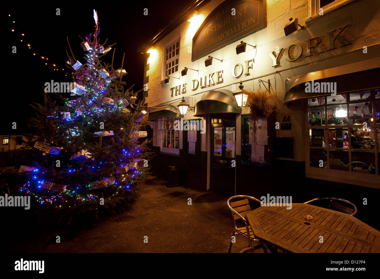 Christmas tree outside pub duke of york cowes isle of wight christmas tree outside pub duke of york cowes isle of wight england uk presents lights xmas garden patio yard deck tables heater mozeypictures Gallery