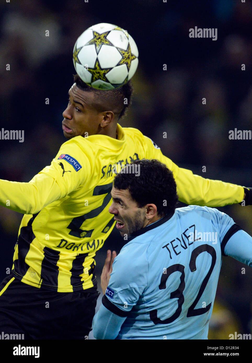 Carlos Dortmund dortmund s felipe santana l and carlos tevez of manchester vie for