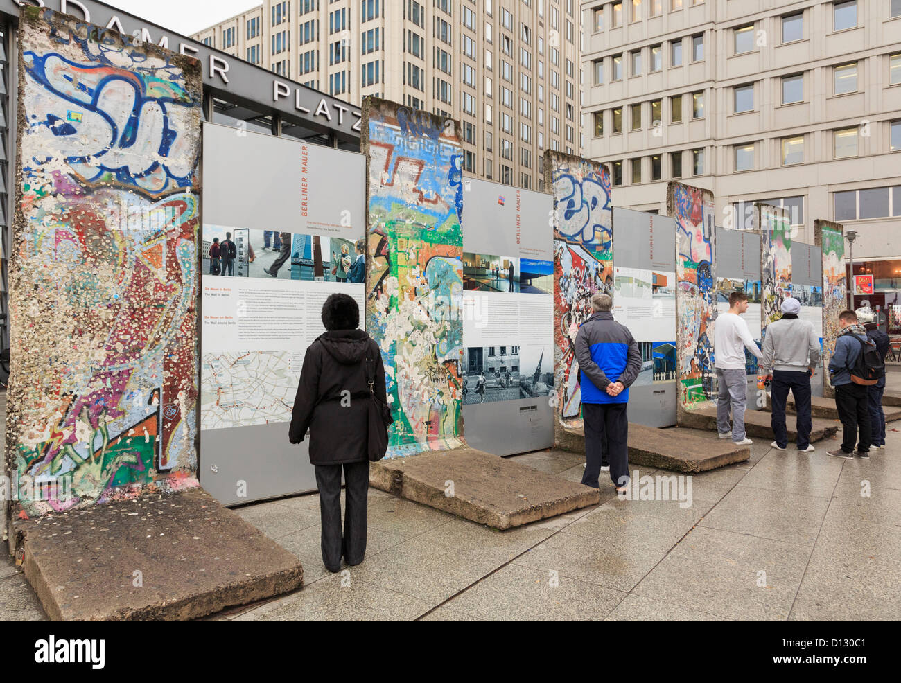 Graffiti wall reading - Stock Photo Street Scene With Tourists Reading Information By Sections Of The Wall Now With Graffiti In Former Death Strip At Potsdamer Platz Berlin