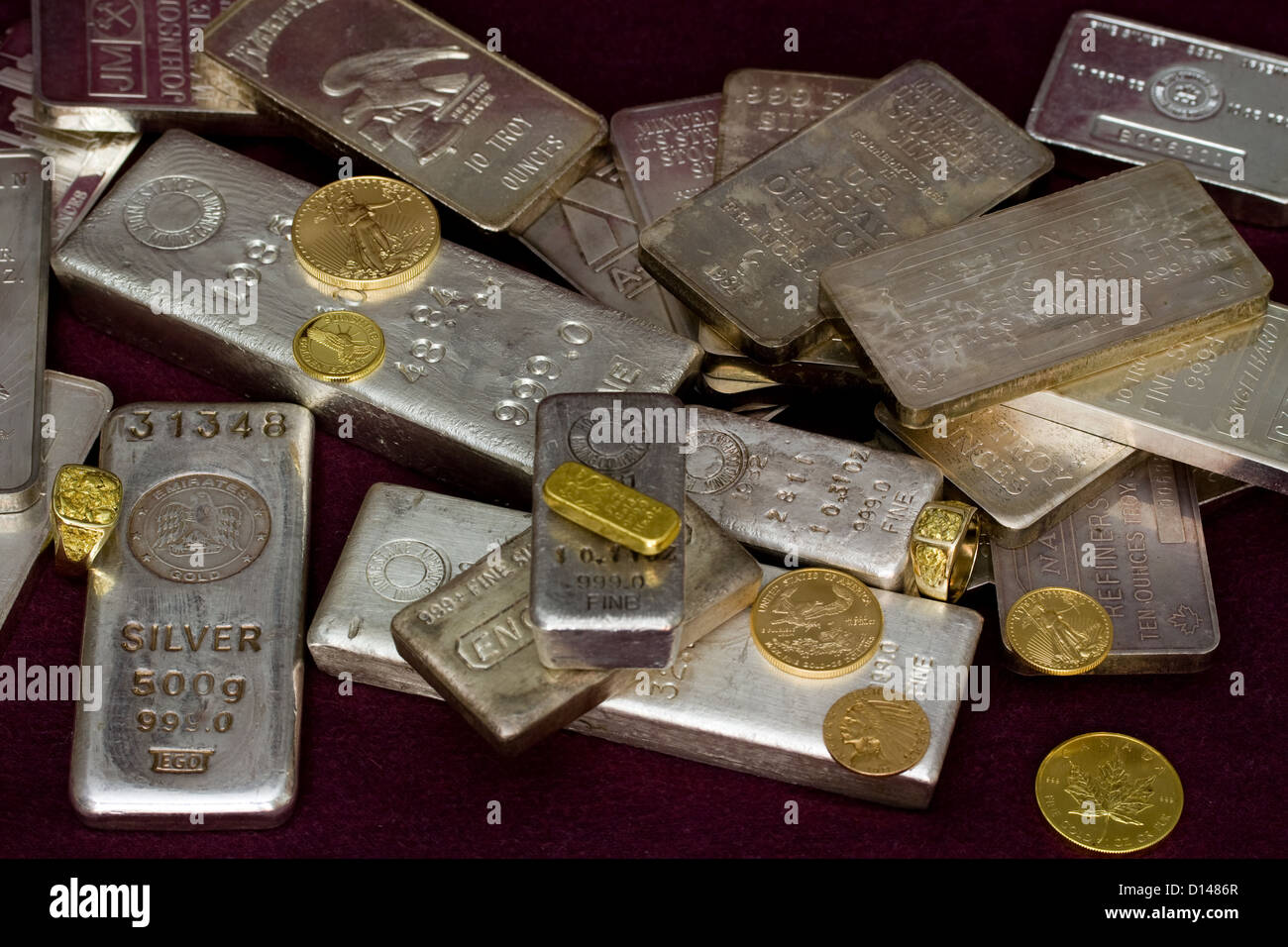 gold and silver bullion bars ingots coins and rings