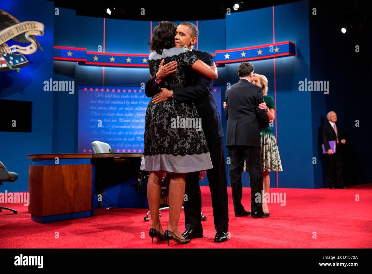 us president barack obama hugs first lady michelle obama