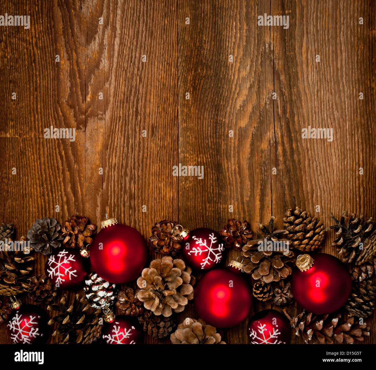 Rustic wood background with Christmas ornaments and pine cones ...
