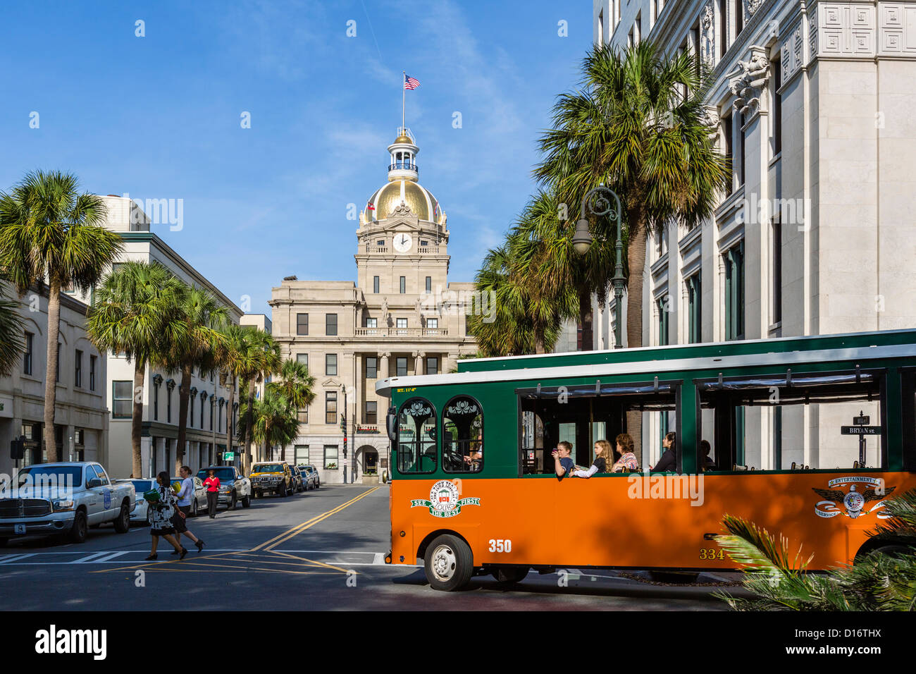 Old Town Trolley Tours On Bull Street With City Hall Behind Savannah Georgia USA