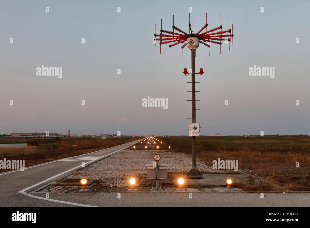 Italy venice international airport landing strip lights at italy venice international airport landing strip lights at sunset mozeypictures Gallery