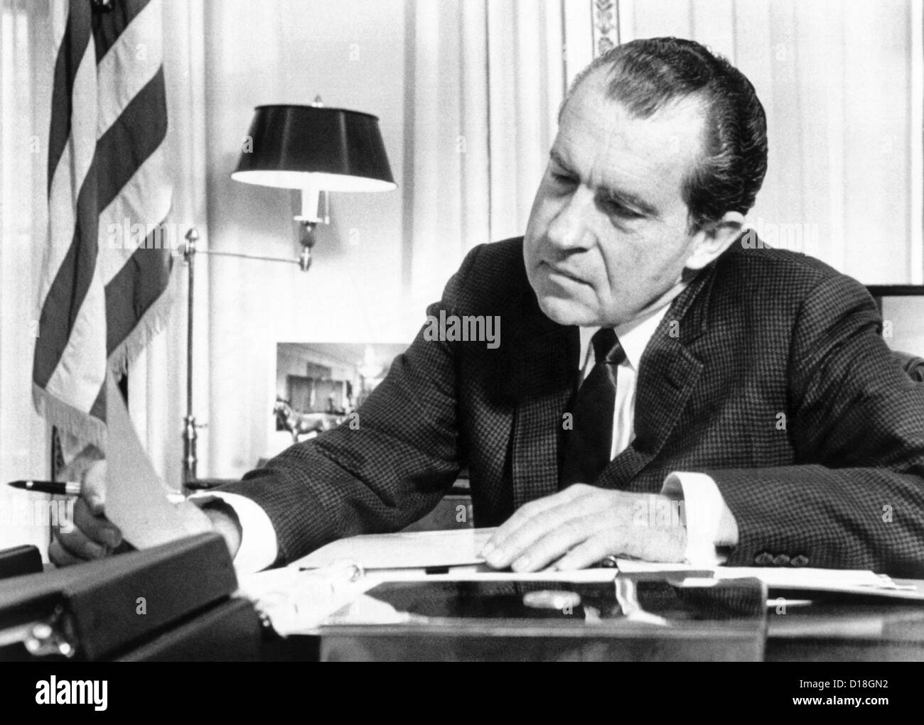 nixon office. president richard nixon in his office at the white house studying background material for upcoming c