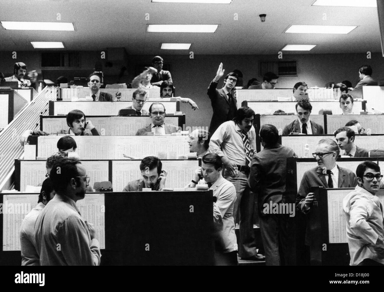 Clerks At The American Stock Exchange Use Hand Signals To