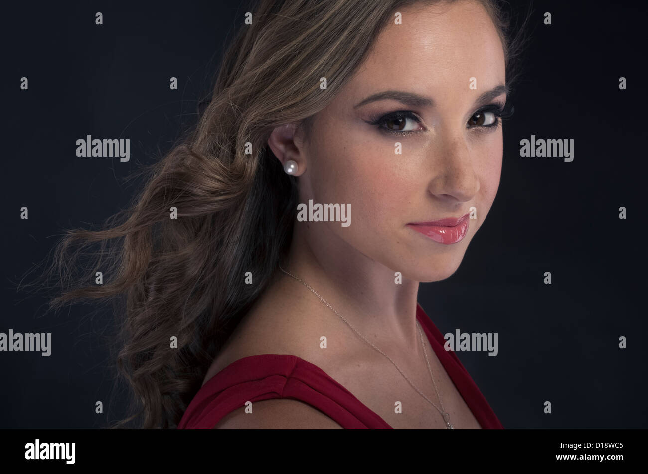 Stock Photo  Woman With Pearl Earrings And Simple Necklace In Red Evening  Dress