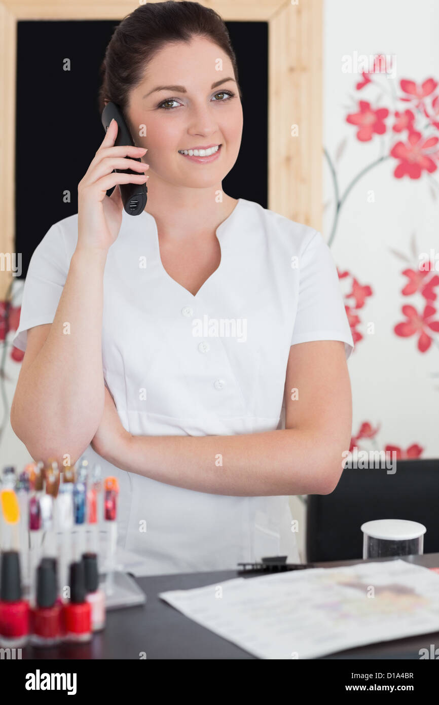 salon receptionist stock photos salon receptionist stock images w answering phone at reception of nail salon stock image