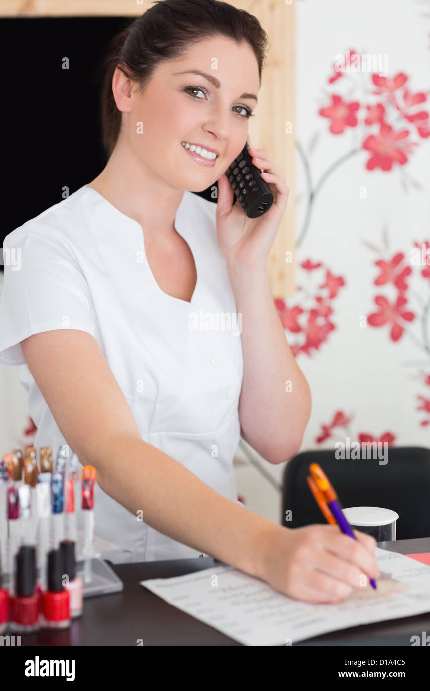 w answering phone at reception of nail salon stock photo stock photo w answering phone at reception of nail salon