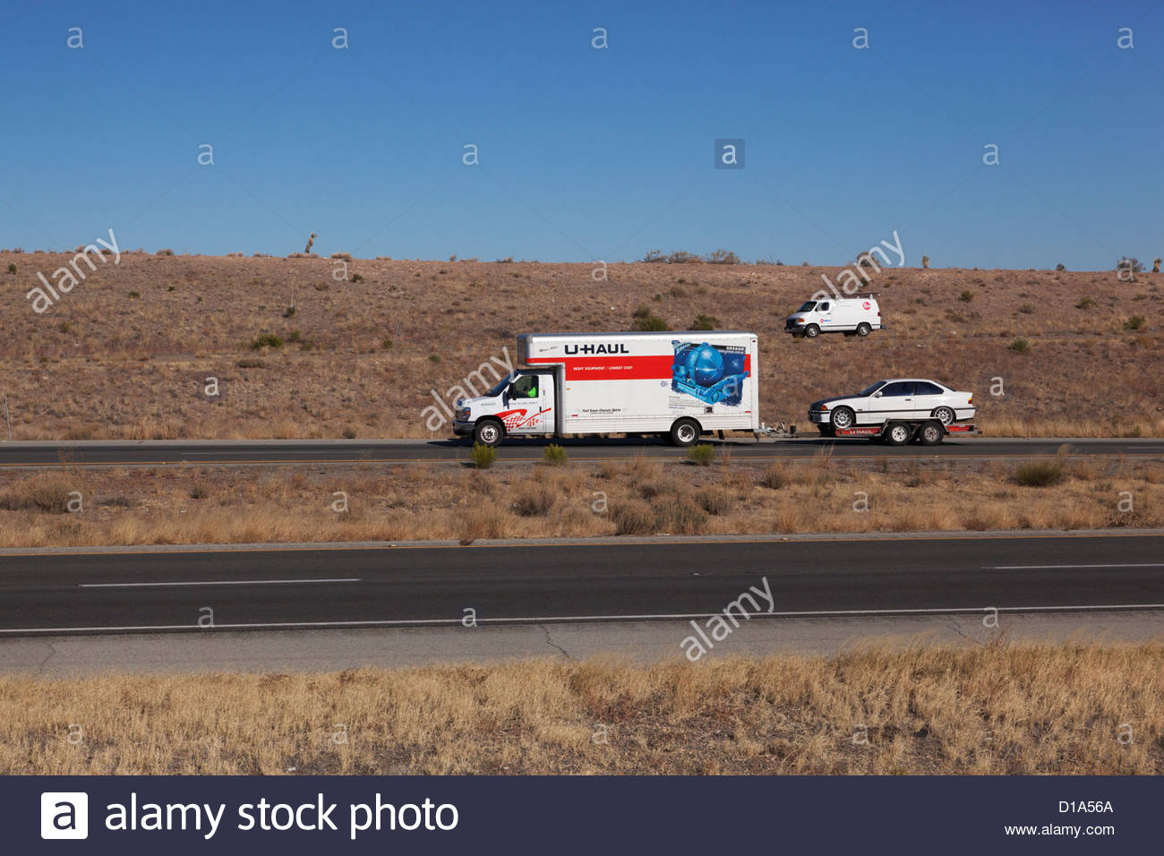 u-haul-truck-pulling-trailer-with-car-arizona-2-drivers-visible-D1A56A.jpg