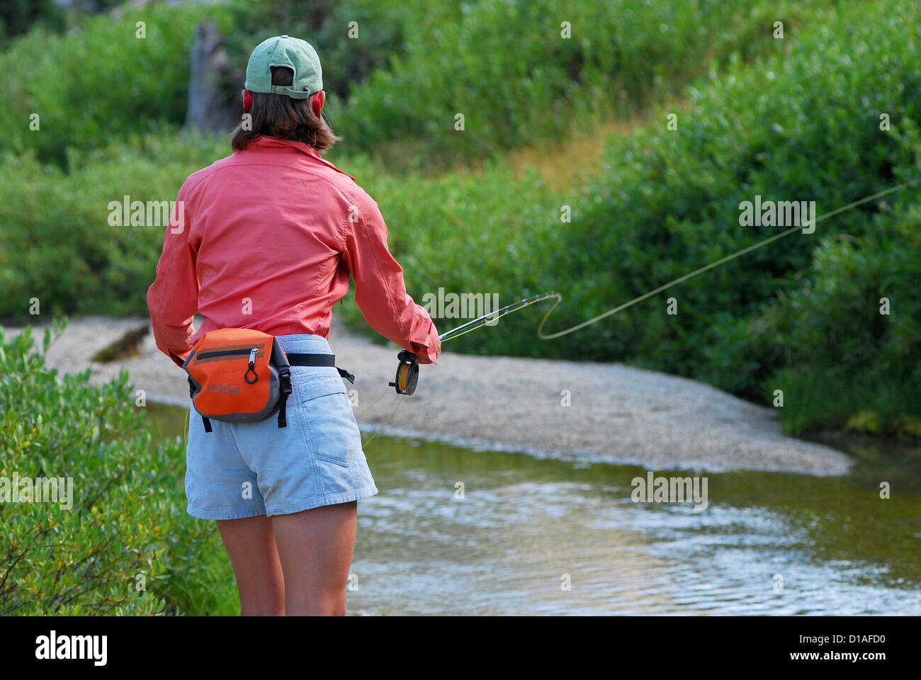 Woman fly fishing in the headwaters of the lostine river for Oregon free fishing