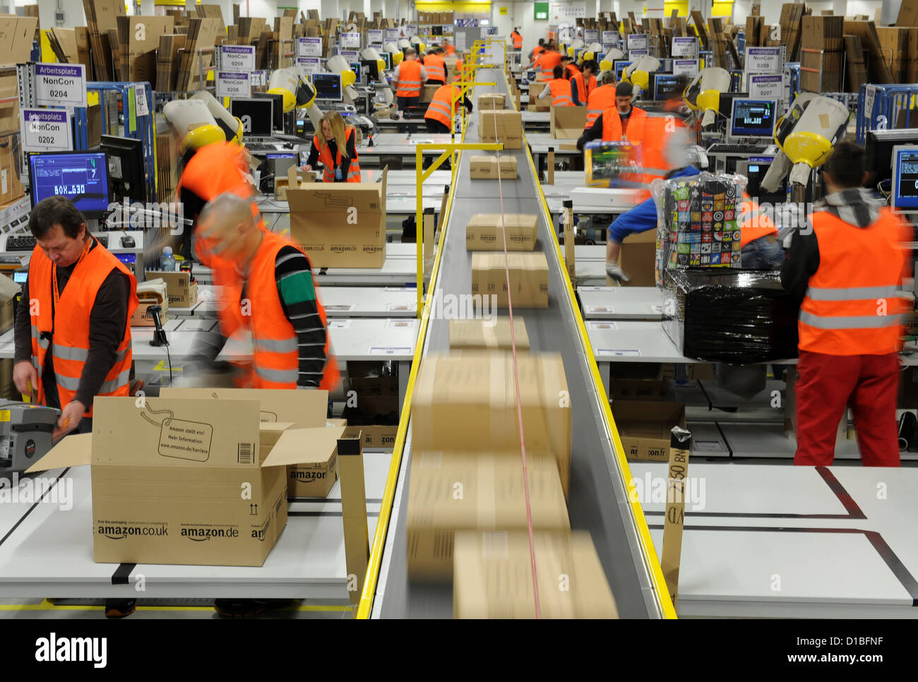 People work in the shipping department in the Amazon Logistics ...