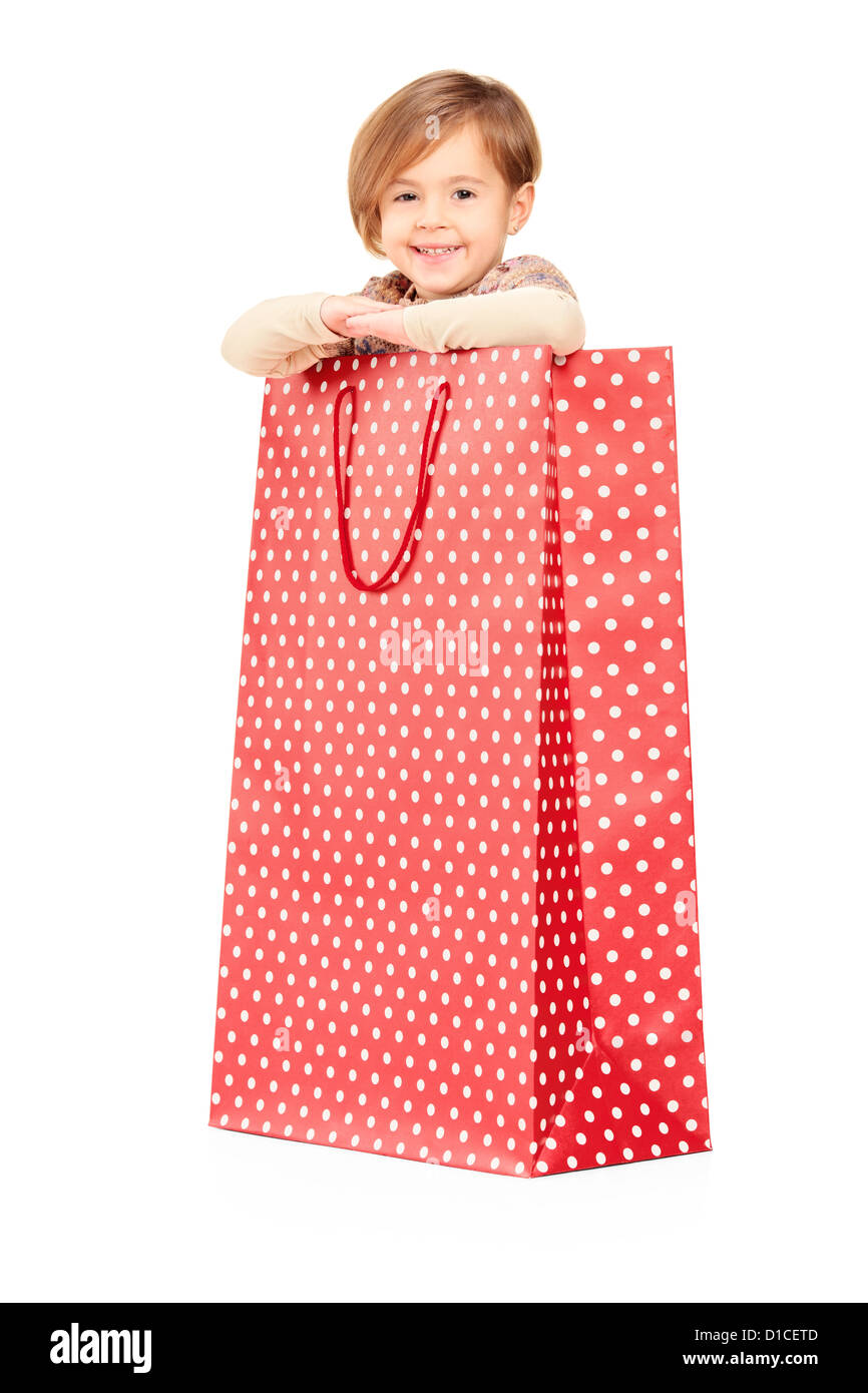 Woman posing with shopping bags isolated on white background full - A Smiling Child Posing In A Red Spotted Shopping Bag Isolated Against White Background