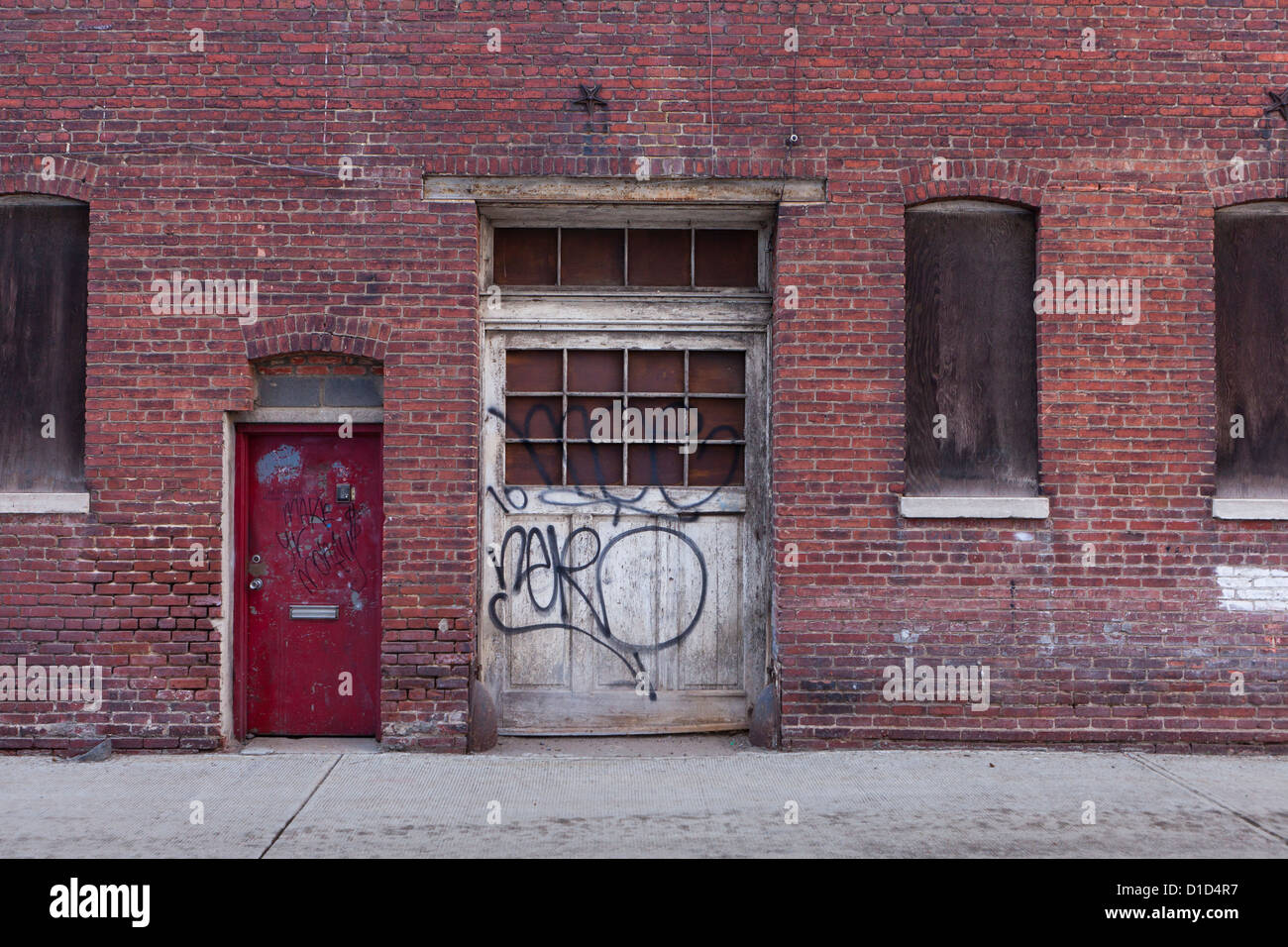 Old garage door of brick building Stock Photo, Royalty Free Image ...