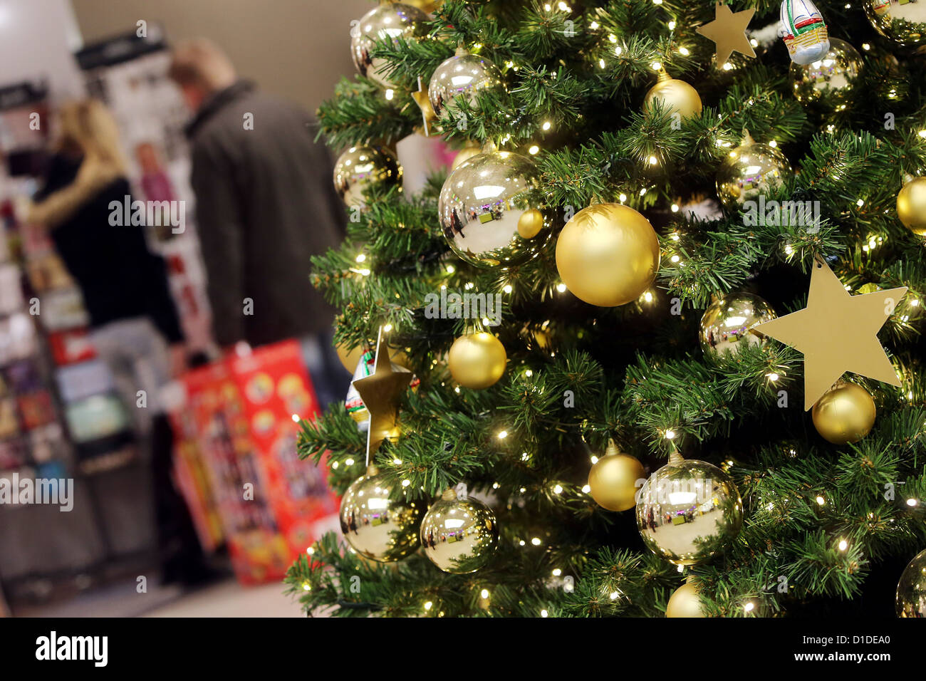 Shoppers Walk Past A Richly Decorated Christmas Tree In A Shopping Centre  In Hamburg, Germany, 17 December 2012. Some People Have Chosing To Do Their  ...