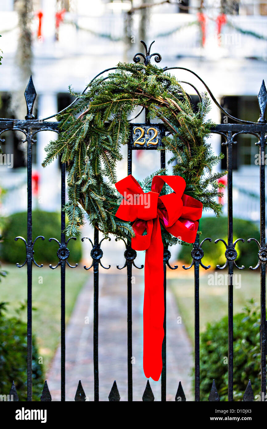 Christmas wreath on an iron gate of a historic home in Charleston ...