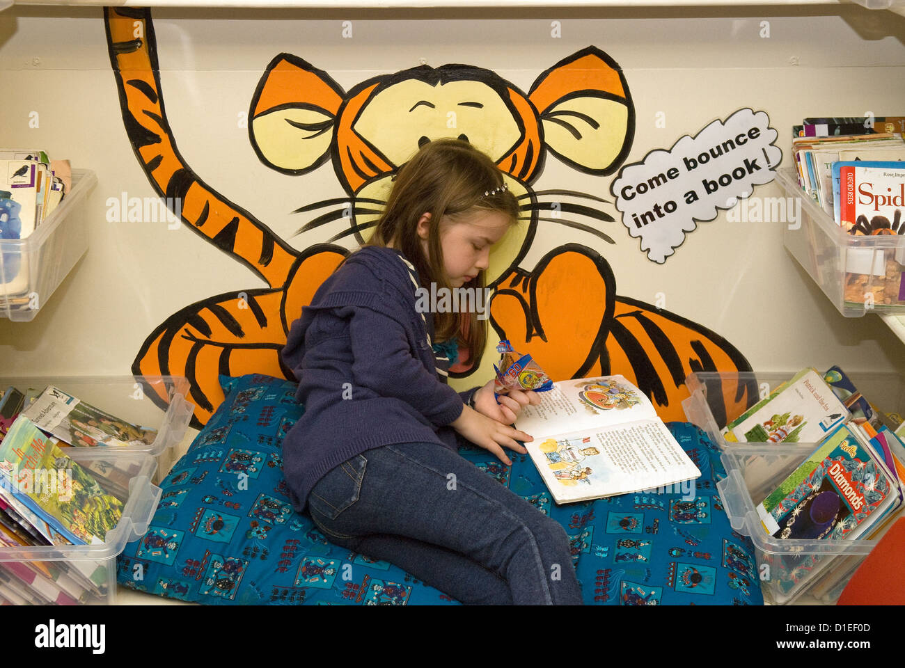 Worksheet Books 7 Year Old 7 year old girl reading book at junior school hampshire uk stock uk