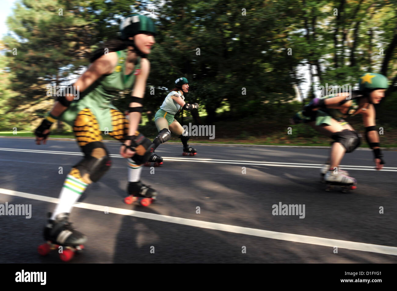 Roller skates york - Stock Photo Three Women Ride Roller Skates In Central Park In Manhattan New York