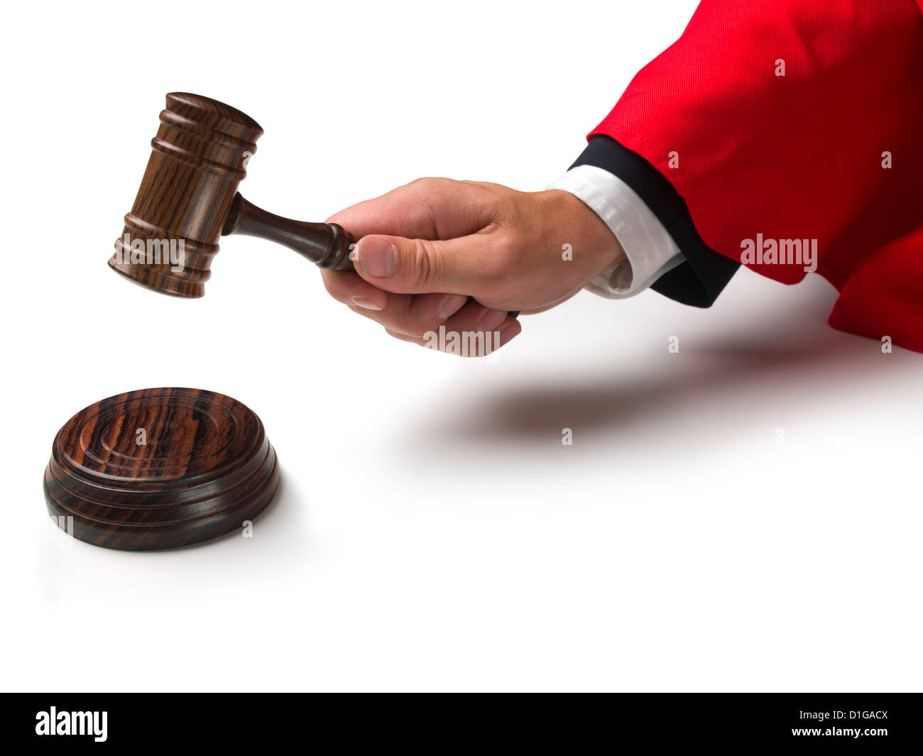 Law court judge\'s hand wearing red gown sleeve banging a gavel ...