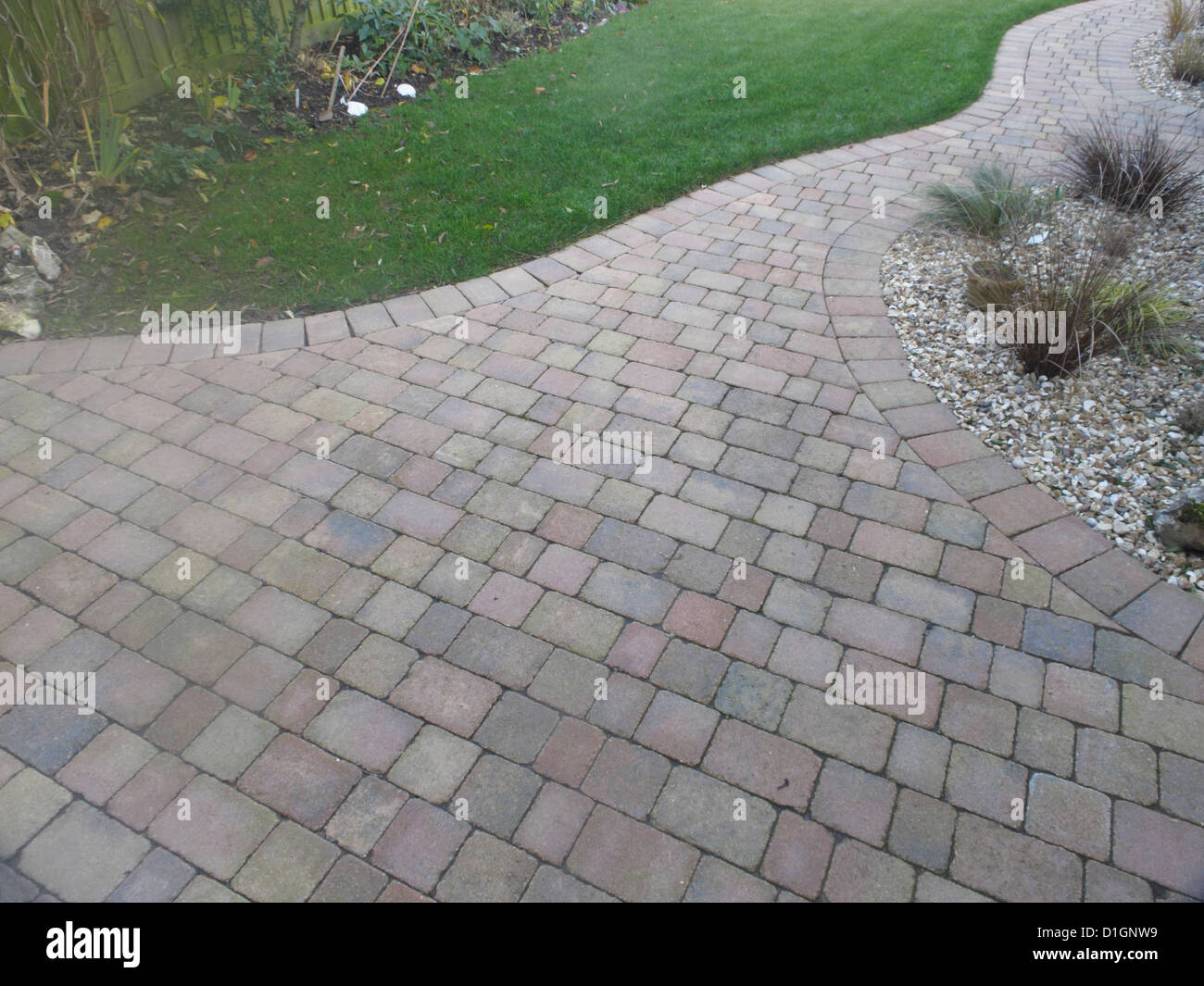 Rustic Red Brick Patio Block Paving In UK Garden With Porous Joints Acting  As Sustainable Drainage