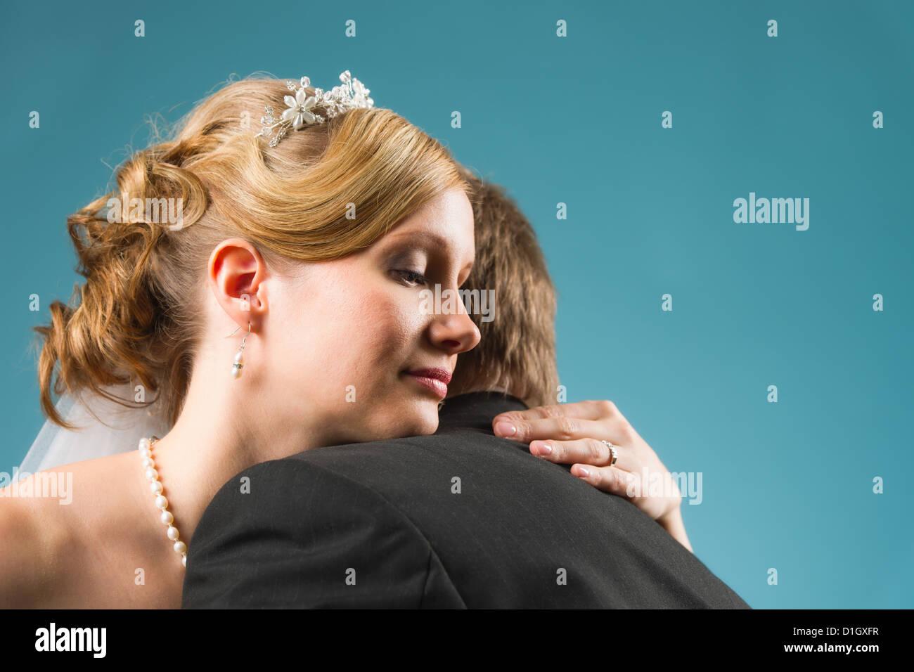 Close up, happy bride hug his groom, blue background Stock ...