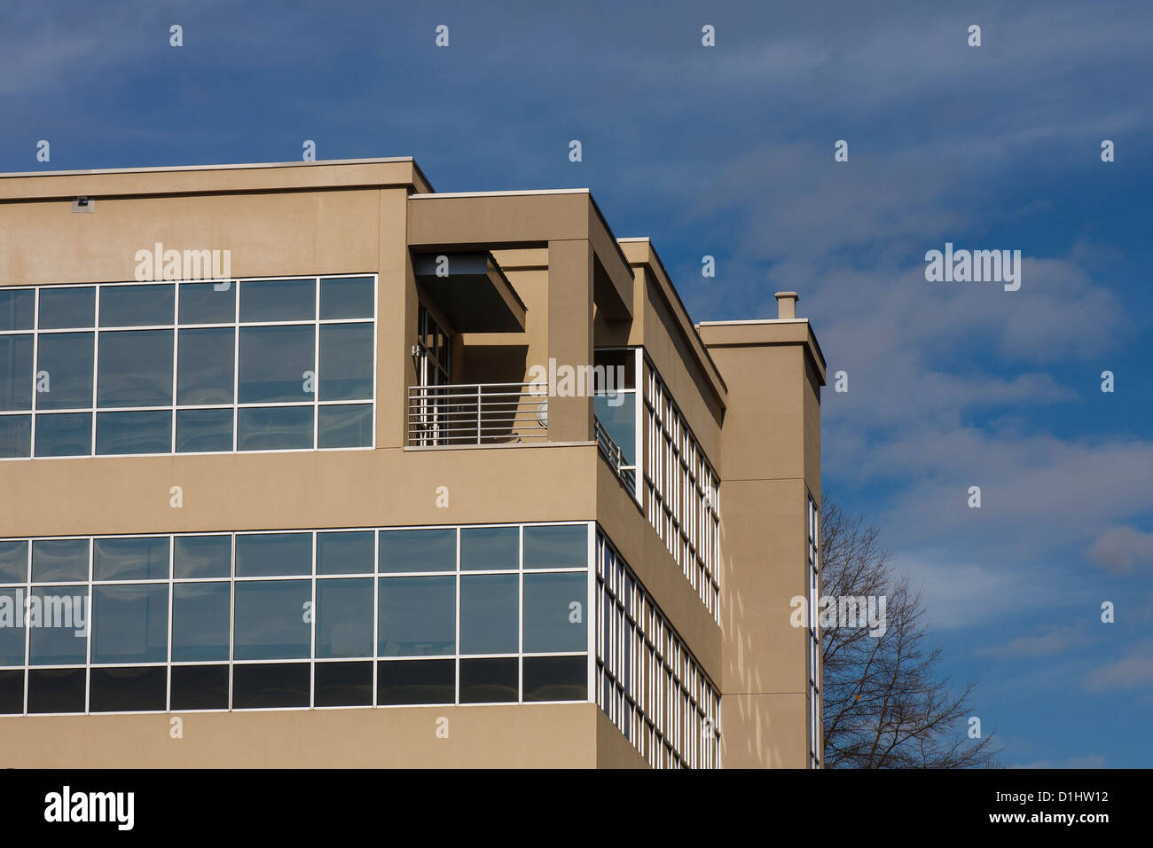 a modern stucco and glass office building with silver chrome trim