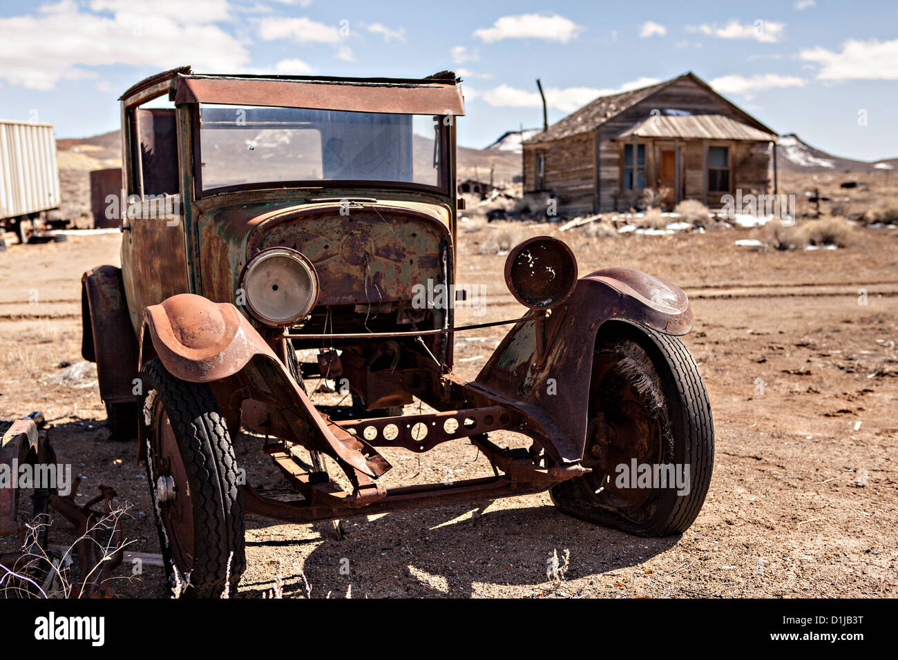 Old rusty cars and abandoned buildings in former gold mining ...