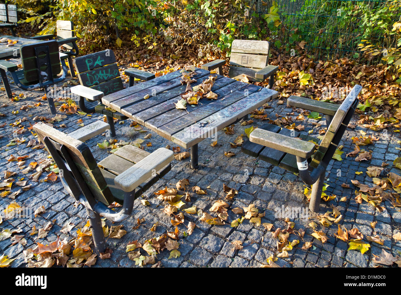 park furniture covered by autumn foliage in the humboldthain park in gesundbrunnen in berlin germany autumn furniture