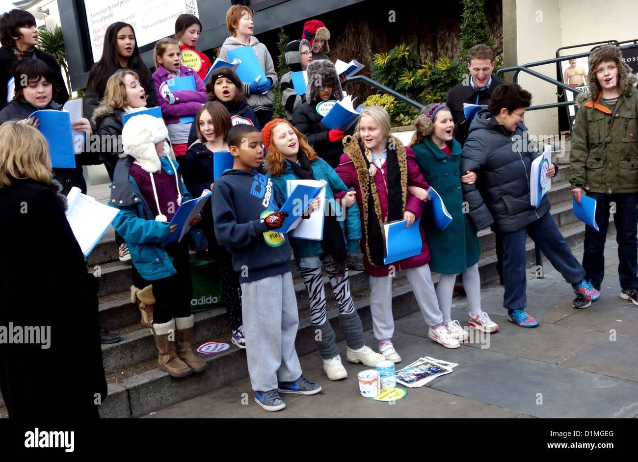 Children's choir sing Christmas carols in London street to raise ...